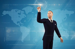 Businessman pushing on a touch screen button Stock Images