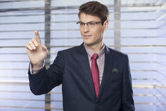 Businessman pushing on a touch screen interface Royalty Free Stock Image