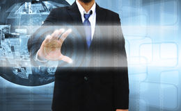 Businessman pushing a touch screen Stock Photography