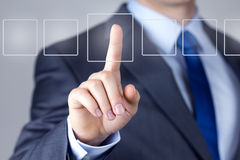 Businessman pushing on a touch screen interface Royalty Free Stock Photos