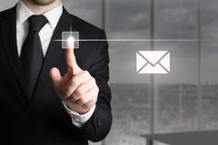 Businessman pushing touchscreen button mail symbol Royalty Free Stock Images