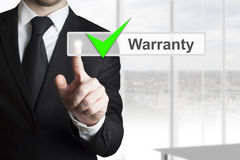 Businessman Pushing Touchscreen Warranty Royalty Free Stock Photography