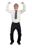 Businessman Pushing Upwards. Young Businessman Pushing Upwards Royalty Free Stock Photos