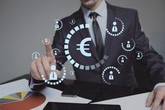 Businessman pushing virtual button eur Royalty Free Stock Photos