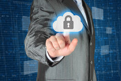 Businessman pushing virtual cloud security button Stock Photos