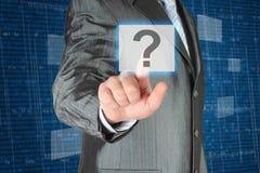 Businessman pushing virtual question button Stock Photos