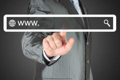 Businessman pushing virtual search bar on black background Stock Images
