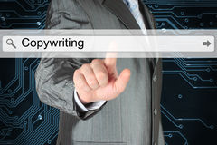 Businessman pushing virtual search bar with copywriting word Stock Photos