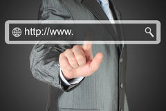 Businessman pushing virtual search bar Stock Photo