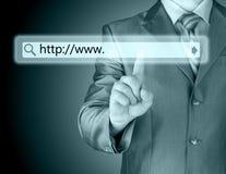 Businessman pushing virtual search bar Royalty Free Stock Photo