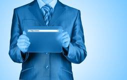 Businessman pushing virtual search bar Royalty Free Stock Image