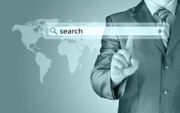 Businessman pushing virtual search bar Royalty Free Stock Photos