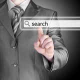 Businessman pushing virtual search bar Royalty Free Stock Photo