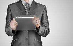 Businessman pushing virtual search bar Stock Images