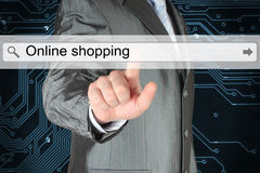 Businessman pushing virtual search bar with online shopping words Stock Photo