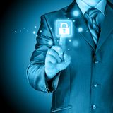 Businessman pushing virtual security button. On digital background Royalty Free Stock Images