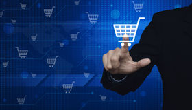 Businessman pushing virtual symbol of online shopping over digit. Al world map technology style, Elements of this image furnished by NASA Stock Photography
