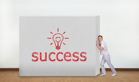 Businessman pushing wall Stock Images
