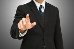 Businessman pushing on the whiteboard Stock Image