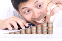 Businessman put coin stack money Royalty Free Stock Images