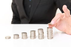 Businessman Put Coins To Stack Of Coins Stock Photography
