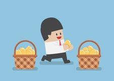 Businessman put golden egg in different basket Royalty Free Stock Images