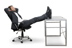 Businessman put his feet up on the table royalty free stock images