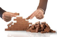 Businessman puts a brick to build a wall. Concept of new business, partnership, integration and startup stock image