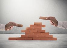 Businessman puts a brick to build a wall. Concept of new business, partnership, integration and startup royalty free stock photo