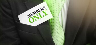 Businessman puts a card with text MEMBERS ONLY in his pocket