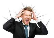 Businessman puts hands on thorned head and shouts Stock Images