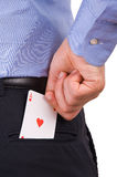 Businessman putting ace card in back pocket. Royalty Free Stock Photo