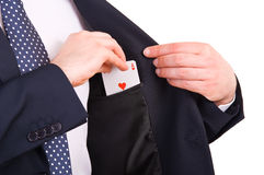 Businessman putting ace card in his pocket. Royalty Free Stock Photo