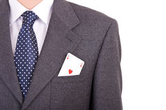 Businessman putting ace card in his pocket. Royalty Free Stock Photography