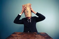 Businessman putting a bag on his head Stock Photography