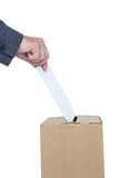 Businessman putting ballot in vote box Royalty Free Stock Photo