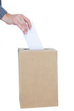 Businessman putting ballot in vote box Royalty Free Stock Image