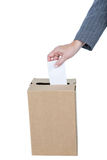 Businessman putting ballot in vote box Stock Photo