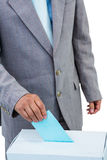 Businessman putting ballot in vote box Royalty Free Stock Photography
