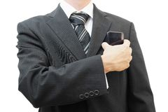 Businessman putting big smart phone into pocket Royalty Free Stock Photo
