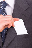 Businessman putting blank card in his pocket. Stock Image