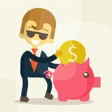 Businessman putting coin into piggy bank Stock Images