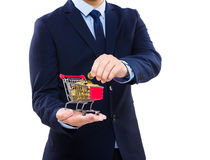 Businessman putting coin into trolley Royalty Free Stock Photo