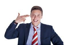 Businessman putting fingers together Stock Image