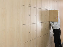 Businessman Putting Head In Small Locker Royalty Free Stock Images