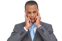 Businessman putting his fingers on his temples Royalty Free Stock Images