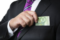 Businessman putting money in pocket Royalty Free Stock Photography