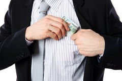 Businessman putting money in pocket Royalty Free Stock Photo