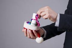 Businessman putting money in a Santa hat Stock Photo