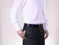 Businessman Putting Money in Your Pocket. Isolated Stock Image
